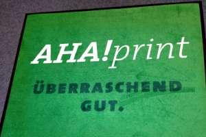 Teppichwerbung Logomatte AHA!print